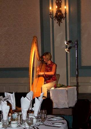 Alison performing amplified harp in ballroom of Victoria hotel