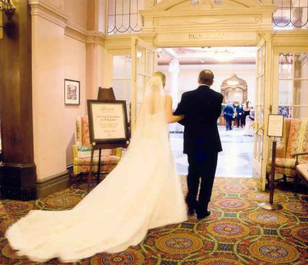Bride and her father entering Palm Court in Fairmont Empress Hotel, Victoria BC